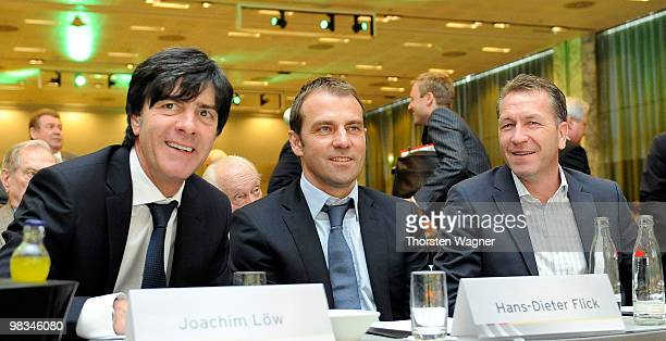 Head coach of German National Football team Joachim Loew second coach Hans Dieter Flick and Andreas Koepke smile during the German Football...