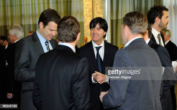Head coach of German National Football team Joachim Loew talks with manager Oliver Bierhoff during the German Football Association Bundestag at the...