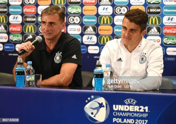 Head coach of Germany Stefan Kuntz and MarcOliver Kempf of Germany speak to the media during a press conference at Krakow Stadium on June 23 2017 in...