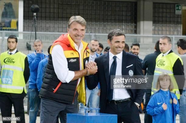 Head coach of Hellas Verona FC Fabio Pecchia shakes hands with Head coach of Benevento Calcio Marco Baroni during the Serie A match between Hellas...