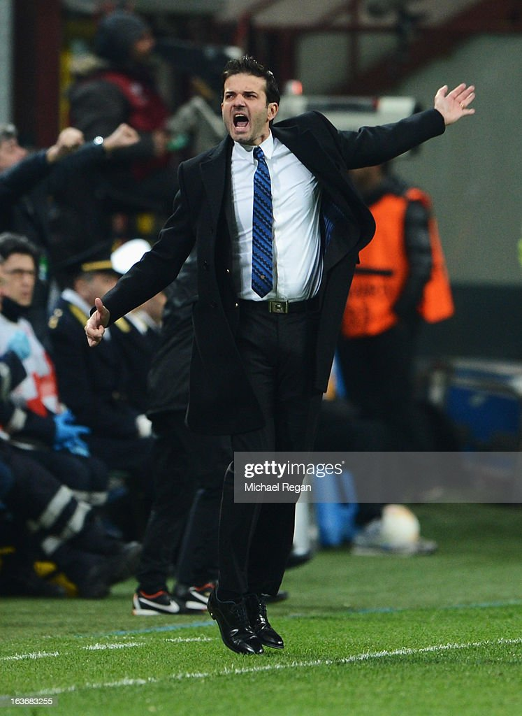 Head coach of Inter Milan <a gi-track='captionPersonalityLinkClicked' href=/galleries/search?phrase=Andrea+Stramaccioni&family=editorial&specificpeople=9070912 ng-click='$event.stopPropagation()'>Andrea Stramaccioni</a> celebrates as Rodrigo Palacio of Inter Milan (not pictured) scores their second goal during UEFA Europa League Round of 16 second leg match between Inter Milan and Tottenham Hotspur at San Siro Stadium on March 14, 2013 in Milan, Italy.