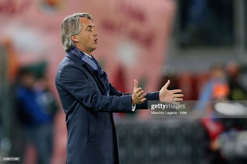 Head coach of Inter <a gi-track='captionPersonalityLinkClicked' href=/galleries/search?phrase=Roberto+Mancini&family=editorial&specificpeople=234429 ng-click='$event.stopPropagation()'>Roberto Mancini</a> gestures during the Serie A match between SS Lazio and FC Internazionale Milano at Stadio Olimpico on May 1, 2016 in Rome, Italy.