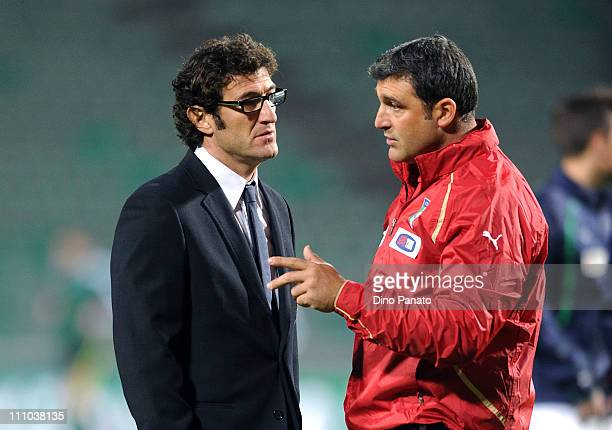 Head coach of Italy U21 Ciro Ferrara talks to Angelo Peruzzi assistant coach of Italy U21 during the international friendly match between Italy U21...