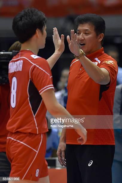 Head coach of Japan Masashi Nambu highfives Masahiro Yanagida after winning the Men's World Olympic Qualification game between Japan and Venezuela at...