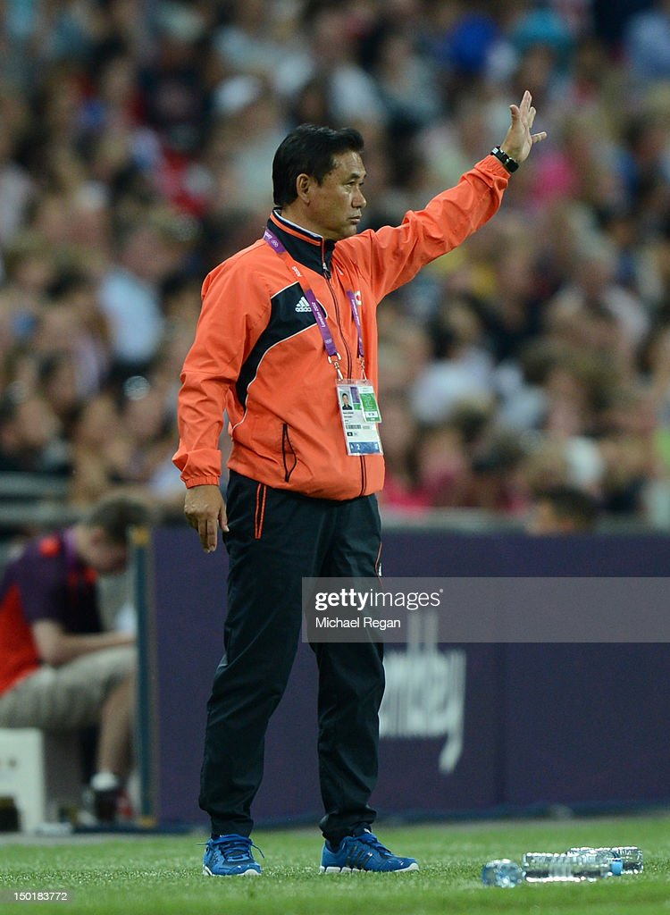 Head coach of Japan Norio Sasaki gives instruction during the Women's Football gold medal match between United States and Japan on Day 13 of the London 2012 Olympic Games at Wembley Stadium on August 9, 2012 in London, England. at Wembley Stadium on August 9, 2012 in London, England.
