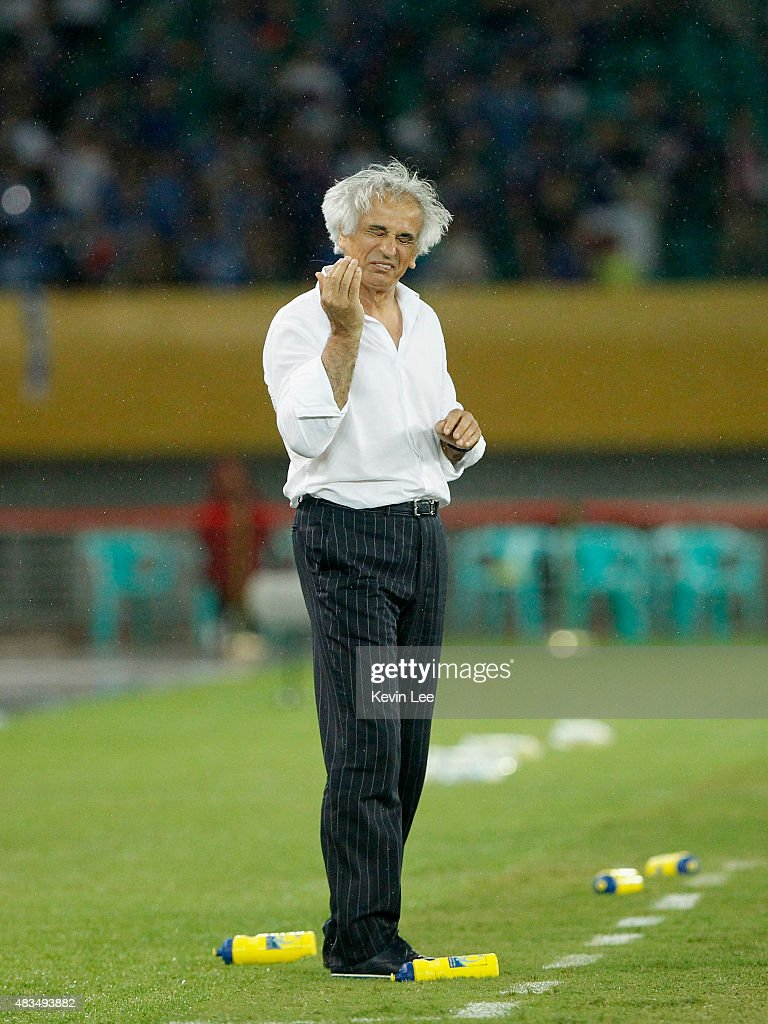Head coach of Japan <a gi-track='captionPersonalityLinkClicked' href=/galleries/search?phrase=Vahid+Halilhodzic&family=editorial&specificpeople=777212 ng-click='$event.stopPropagation()'>Vahid Halilhodzic</a> reacts in a match against China during the EAFF East Asian Cup 2015 final round at the Wuhan Sports Center Stadium on August 9, 2015 in Wuhan, China.