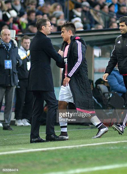 Head coach of Juventus Massimiliano Allegri shakes hands with Paulo Dybala during the Serie A match between Udinese Calcio and Juventus FC at Stadio...