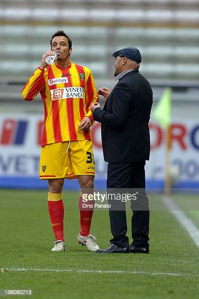Head coach of Lecce Serse Cosmi speakes with Massimo Oddo during the Serie A match between Parma FC and US Lecce at Stadio Ennio Tardini on December...