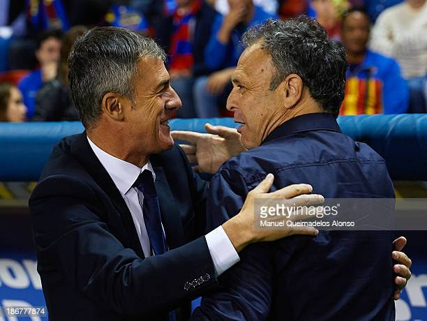 Head Coach of Levante UD Joaquin Caparros embrance to Head Coach of Granada CF Lucas Alcaraz prior to the La Liga match between Levante UD and...