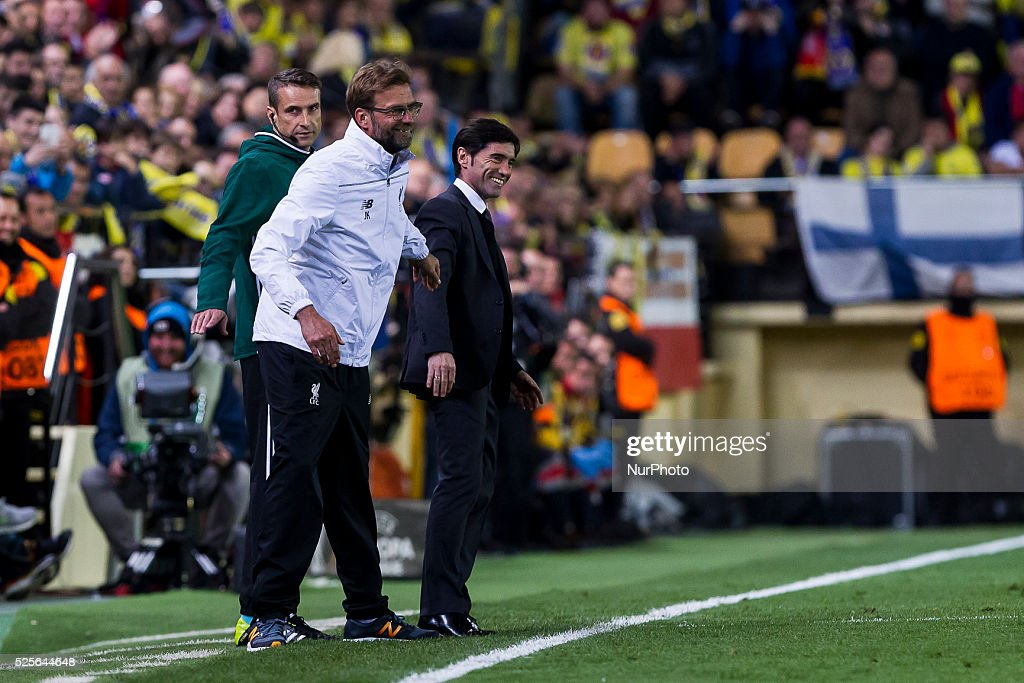Head coach of Liverpool FC Jurgen Klopp (L) and Head coach of Villarreal CF Marcelino Garcia Toral (R) during UEFA Europa League semi-final first leg match between Villarreal CF and Liverpool FC at El Madrigal Stadium in Villarreal on April 28, 2016.