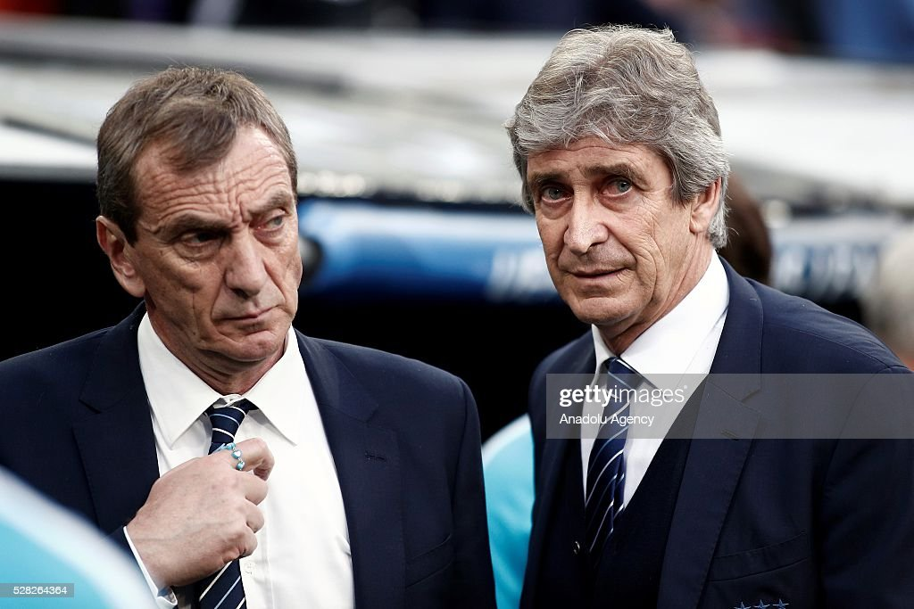 Head coach of Manchester City Manuel Pellegrini (R) is seen during the UEFA Champions League semi-final second leg football match between Real Madrid and Manchester City at the Santiago Bernabeu Stadium in Madrid, Spain on May 4, 2016.