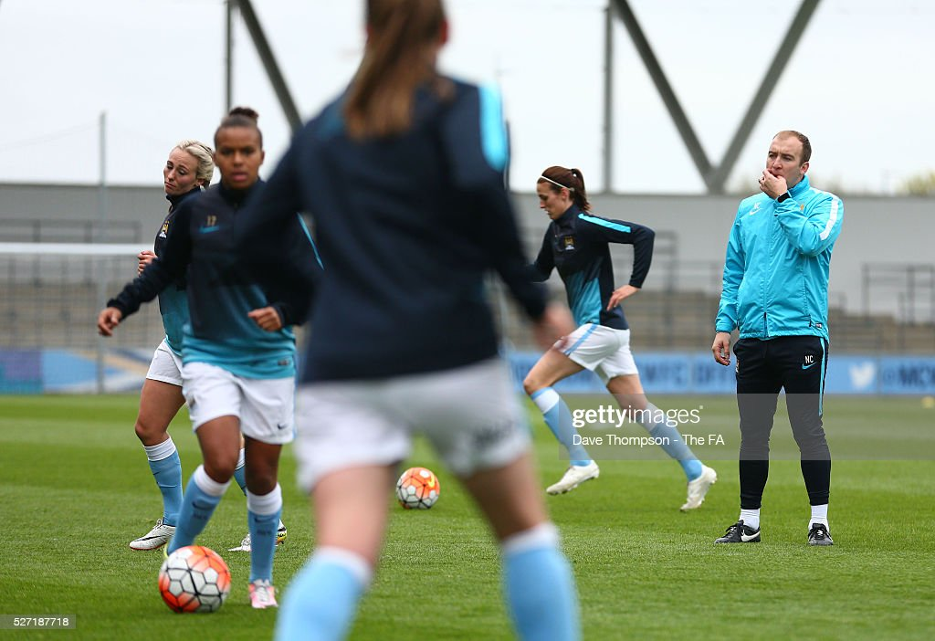 Head Coach of Manchester City Women Nick Cushing warms up his players during the game between Manchester City Women and Doncaster Belles at the Manchester City Academy Stadium on May 2, 2016 in Manchester, England.