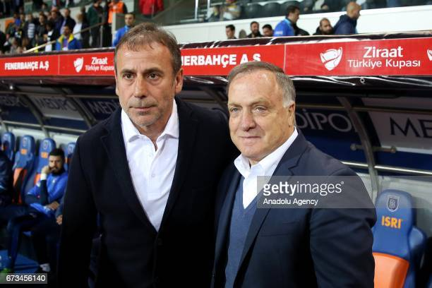 Head Coach of Medipol Basaksehir Abdullah Avci poses for a photo with Head Coach of Fenerbahce Dick Advocaat prior to the Ziraat Turkish Cup semi...