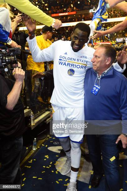 Head coach of Michigan State basketball Tom Izzo and Draymond Green of the Golden State Warriors walk off the court after Game One of the 2017 NBA...