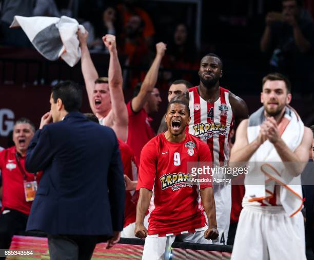 Head Coach of Olympiacos Ioannis Sfairopoulos and basketball players celebrate after they won the Turkish Airlines Euroleague Final Four basketball...