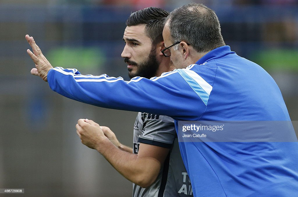 Head coach of OM <a gi-track='captionPersonalityLinkClicked' href=/galleries/search?phrase=Marcelo+Bielsa&family=editorial&specificpeople=2396264 ng-click='$event.stopPropagation()'>Marcelo Bielsa</a> gives instructions to <a gi-track='captionPersonalityLinkClicked' href=/galleries/search?phrase=Romain+Alessandrini&family=editorial&specificpeople=9572619 ng-click='$event.stopPropagation()'>Romain Alessandrini</a> of OM during the French Ligue 1 match between Stade Malherbe de Caen and Olympique de Marseille at Stade Michel D'Ornano on October 4, 2014 in Caen, France.