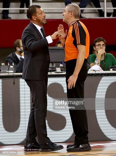 Head coach of Pinar Karsiyaka Ufuk Sarca argues with the referee during the Turkish Airlines Euroleague Group C match between Pinar Karsiyaka and...