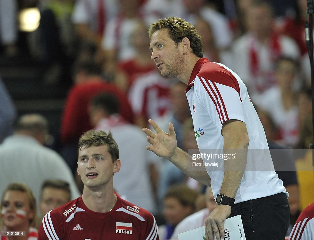 Head coach of Poland Stephane Antiga speaks to his player Piotr Nowakowski during the FIVB World Championships match between Australia and Poland on September 2, 2014 in Wroclaw, Poland.