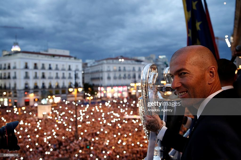 Head Coach of Real Madrid Zinedine Zidane greets fans during their visit to President of the Community of Madrid Cristina Cifuentes after Real Madrid won the UEFA Champions League Final match against Club Atletico de Madrid, at Madrid City Hall in Madrid, Spain on May 29, 2016.