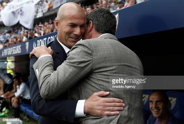 Head Coach of Real Madrid Zinedine Zidane hugs with Head Coach of Malaga Michel ahead of the La Liga match between Malaga and Real Madrid at La...