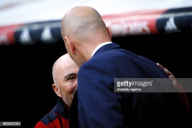 Head coach of Real Madrid Zinedine Zidane talks with head coach of Sevilla Jorge Sampaoli ahead of the La Liga match between Real Madrid and Sevilla...