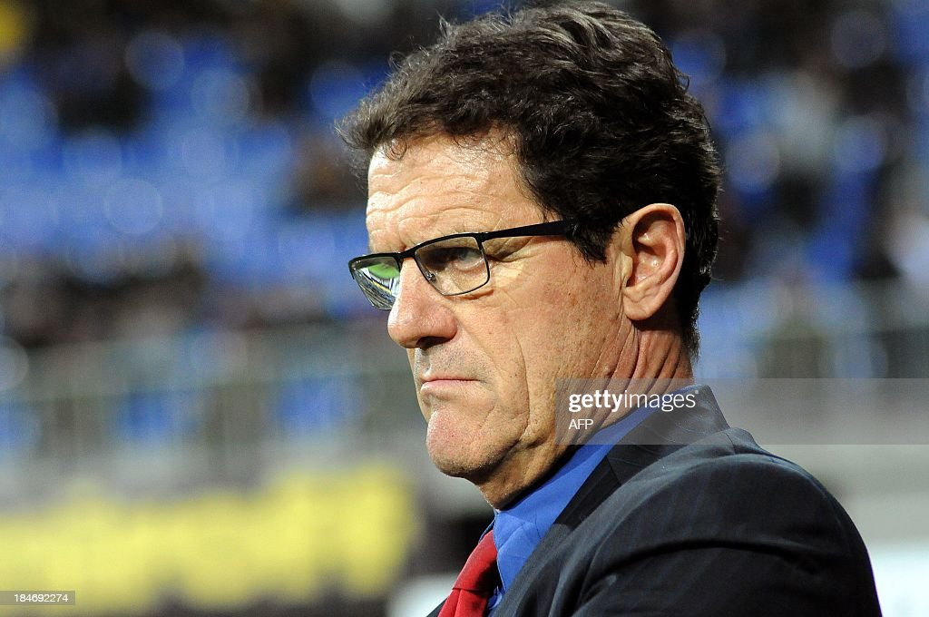 Head coach of Russian national team <a gi-track='captionPersonalityLinkClicked' href=/galleries/search?phrase=Fabio+Capello&family=editorial&specificpeople=241290 ng-click='$event.stopPropagation()'>Fabio Capello</a> reacts during the FIFA World Cup 2014 qualifying football match between Azerbaijan and Russia in Baku on October 15, 2013.