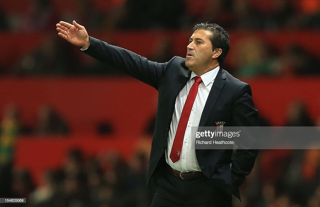 Head Coach of SC Braga <a gi-track='captionPersonalityLinkClicked' href=/galleries/search?phrase=Jose+Peseiro&family=editorial&specificpeople=2204654 ng-click='$event.stopPropagation()'>Jose Peseiro</a> gestures during the UEFA Champions League Group H match between Manchester United and SC Braga at Old Trafford on October 23, 2012 in Manchester, England.