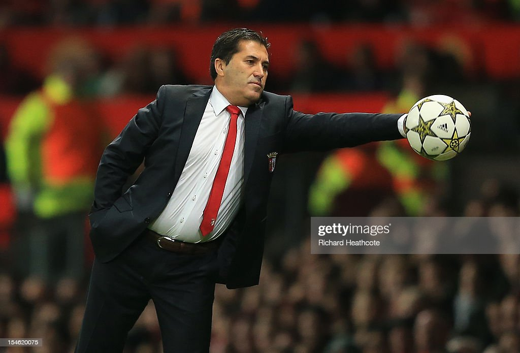 Head Coach of SC Braga <a gi-track='captionPersonalityLinkClicked' href=/galleries/search?phrase=Jose+Peseiro&family=editorial&specificpeople=2204654 ng-click='$event.stopPropagation()'>Jose Peseiro</a> stops the ball during the UEFA Champions League Group H match between Manchester United and SC Braga at Old Trafford on October 23, 2012 in Manchester, England.