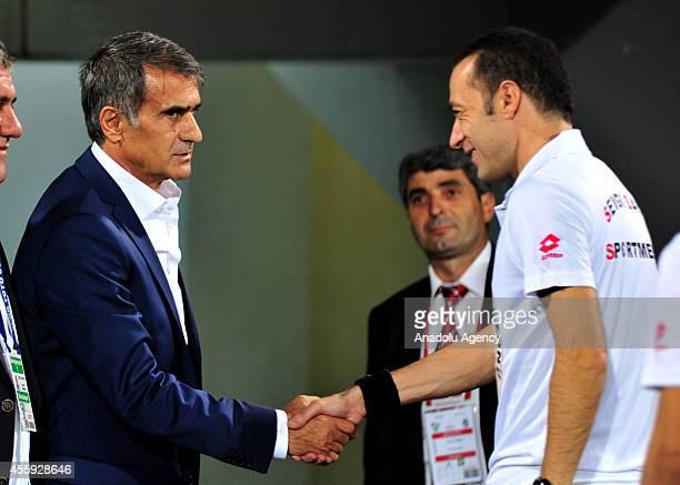 Head coach of Senol Gunes and referee Cuneyt Cakir shake hands ahead of Turkish Spor Toto Super League match between Bursaspor and Besiktas at Bursa...