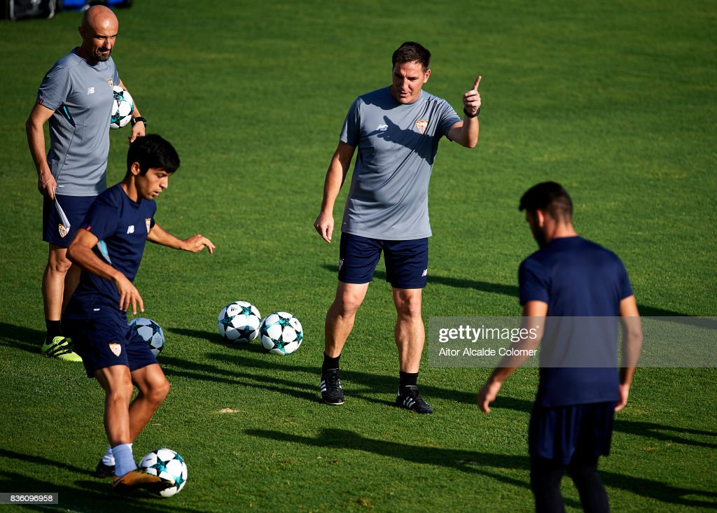 Head Coach of Sevilla FC Eduardo Berizzo (C) gives instructions to Borja Lasso of Sevilla FC (L) during the training session prior to their UEFA Champions League match against Istanbul Basaksehir at the Sevilla FC training ground on August 21, 2017 in Seville, Spain.