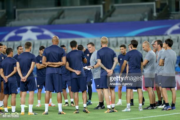 Head coach of Sevilla FC Eduardo Berizzo talks with his players during a training session ahead of the UEFA Champions League playoff match between...
