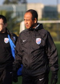 Head coach of Shanghai Shenhua Football Club Jean Tigana looks on during a training session at Hongta Sports Center on January 5 2012 in Kunming China