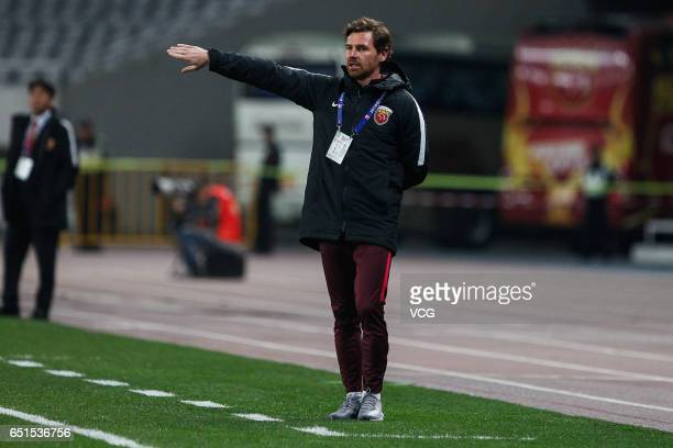 Head coach of Shanghai SIPG Andre Villas Boas speaks to his players during the 2nd round match of Chinese Super League between Shanghai SIPG and...