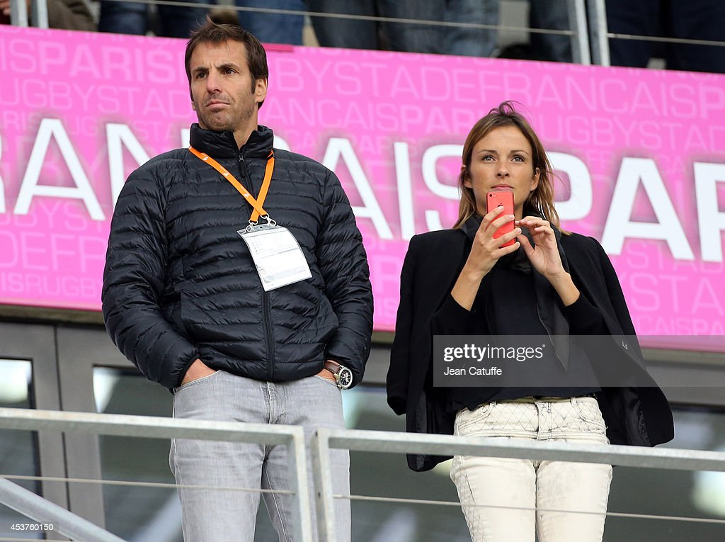 Head coach of Stade Francais <a gi-track='captionPersonalityLinkClicked' href=/galleries/search?phrase=Gonzalo+Quesada&family=editorial&specificpeople=685928 ng-click='$event.stopPropagation()'>Gonzalo Quesada</a> and his wife Canal Plus journalist Isabelle Uthurburu attend the IRB Women's Rugby World Cup 2014 3rd/4th Place Playoff between France and Ireland at Stade Jean-Bouin on August 17, 2014 in Paris, France.