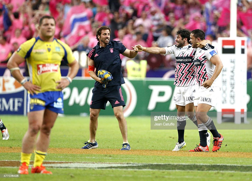 Head coach of Stade Francais <a gi-track='captionPersonalityLinkClicked' href=/galleries/search?phrase=Gonzalo+Quesada&family=editorial&specificpeople=685928 ng-click='$event.stopPropagation()'>Gonzalo Quesada</a> celebrates the victory with <a gi-track='captionPersonalityLinkClicked' href=/galleries/search?phrase=Jerome+Fillol&family=editorial&specificpeople=698636 ng-click='$event.stopPropagation()'>Jerome Fillol</a> after the Top 14 Final between ASM Clermont Auvergne and Stade Francais Paris at Stade de France on June 13, 2015 in Saint-Denis nearby Paris, France.