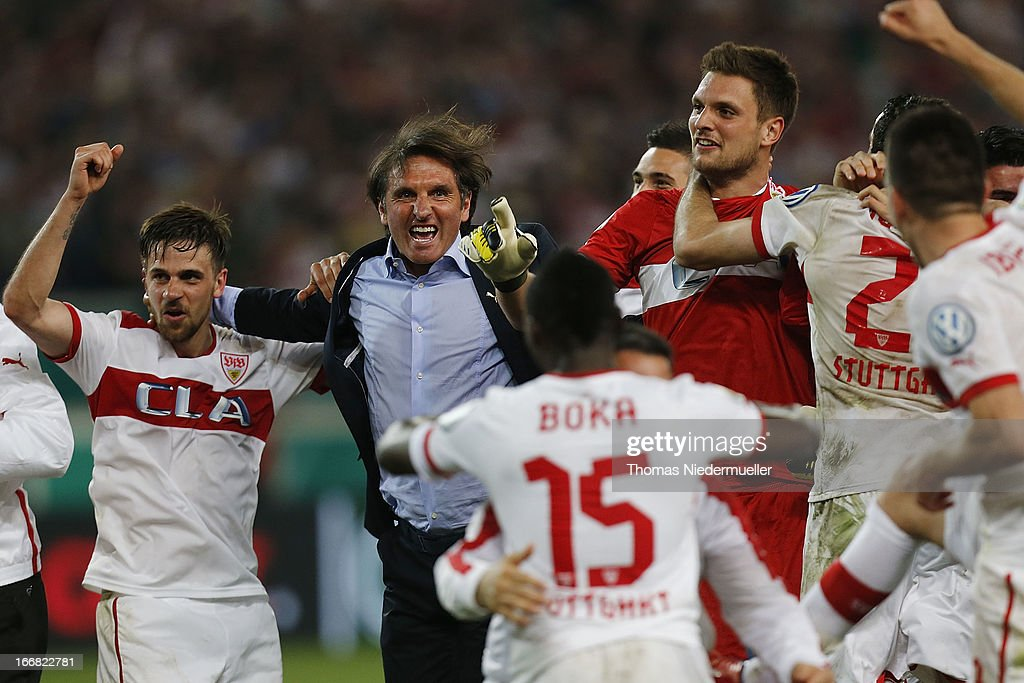Head coach of Stuttgart <a gi-track='captionPersonalityLinkClicked' href=/galleries/search?phrase=Bruno+Labbadia&family=editorial&specificpeople=653790 ng-click='$event.stopPropagation()'>Bruno Labbadia</a> (2L) celebrates wth his team after the DFB Cup Semi Final match between VfB Stuttgart and SC Freiburg at Mercedes-Benz Arena on April 17, 2013 in Stuttgart, Germany.