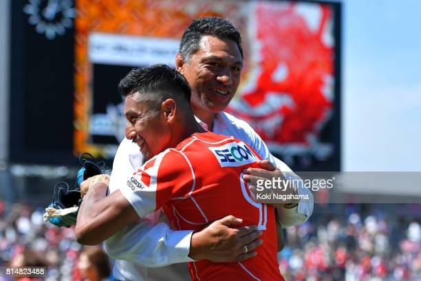 Head Coach of Sunwolves Filo Tiatia and Keisuke Uchida of Sunwolves hug after winning the Super Rugby match between the Sunwolves and the Blues at...