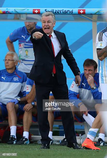 Head coach of Switzerland Ottmar Hitzfeld gestures during the 2014 FIFA World Cup Brazil Round of 16 match between Argentina and Switzerland at Arena...