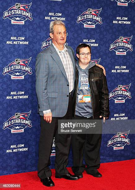 Head coach of Team Foligno Darryl Sutter of the Los Angeles Kings and his son Chris Sutter arrive pose on the red carpet for the 2015 NHL AllStar...