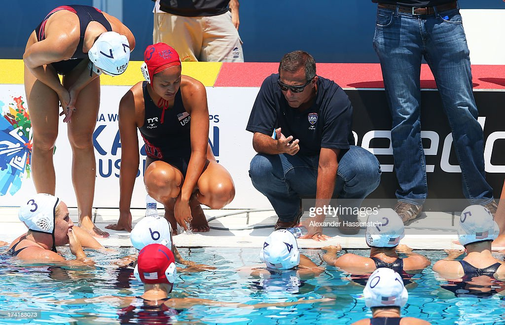 Head Coach of Team USA Adam Krikorian speaks to his players during the Women's Water Polo first preliminary round match between USA and Greece during Day Two of the 15th FINA World Championships at Piscines Bernat Picornell on July 21, 2013 in Barcelona, Spain.