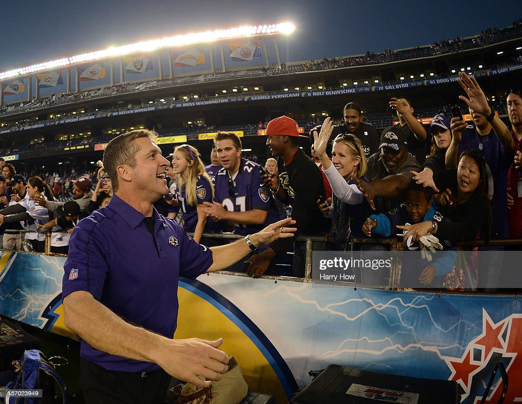 Head Coach of the Baltimore Ravens <a gi-track='captionPersonalityLinkClicked' href=/galleries/search?phrase=John+Harbaugh&family=editorial&specificpeople=763525 ng-click='$event.stopPropagation()'>John Harbaugh</a>, celebrates a 16-13 win over the San Diego Chargers with fans at Qualcomm Stadium on November 25, 2012 in San Diego, California.
