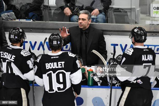 Head coach of the BlainvilleBoisbriand Armada Joel Bouchard regroups his team against the Drummondville Voltigeurs during the QMJHL game at Centre...