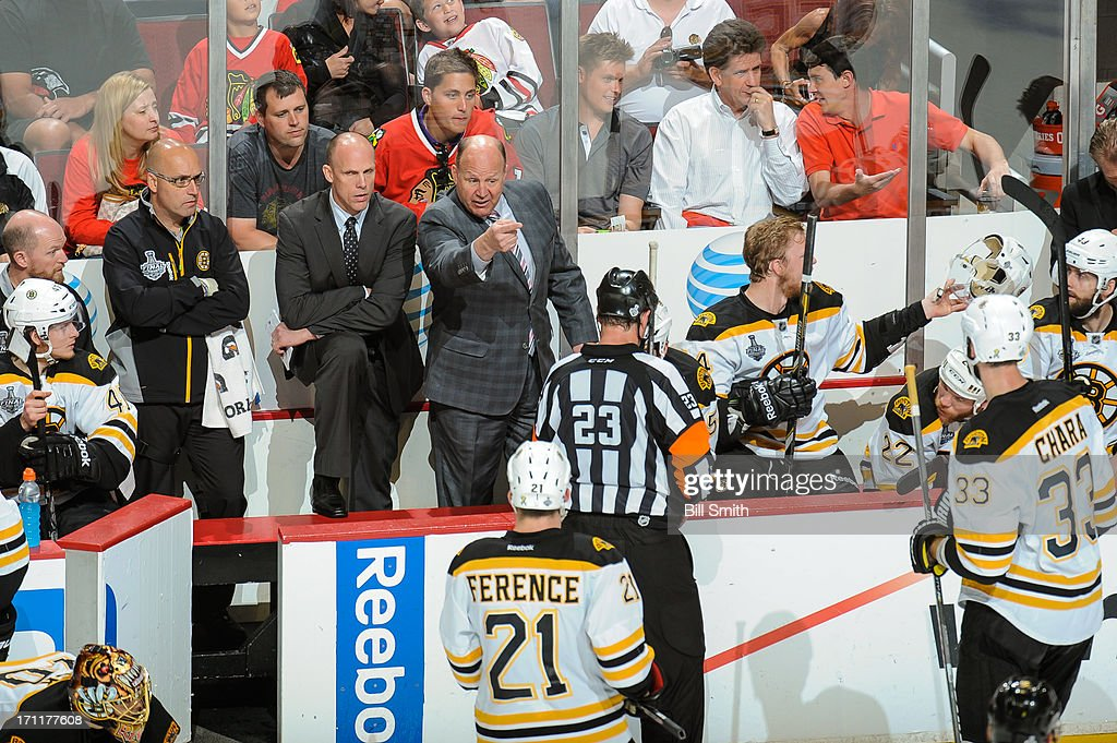 Head coach of the Boston Bruins, Claude Julien, talks with referee Brad Watson #23, next to assistant coach Doug Houda, in Game Five of the Stanley Cup Final against the Chicago Blackhawks at the United Center on June 22, 2013 in Chicago, Illinois.