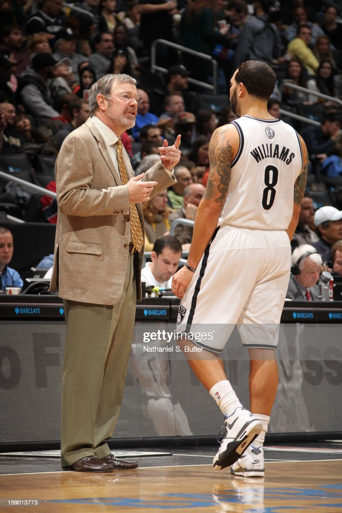 Head coach of the Brooklyn Nets P.J. Carlesimo talks to Deron Williams #8 during a game against the Sacramento Kings on January 5, 2013 at the Barclays Center in the Brooklyn borough of New York City.