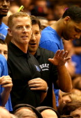 Head coach of the Dallas Cowboys Jason Garrett and Tony Romo watch on during the game between the North Carolina Tar Heels and Duke Blue Devils at...