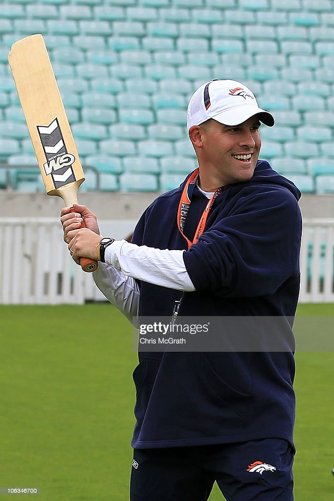 Head coach of the Denver Broncos Josh McDaniels jokes around while playing cricket prior to the start of a team training session at The Brit Oval on October 29, 2010 in London, England. The Denver Broncos will play the San Francisco 49ers at Wembley Stadium on October 31.
