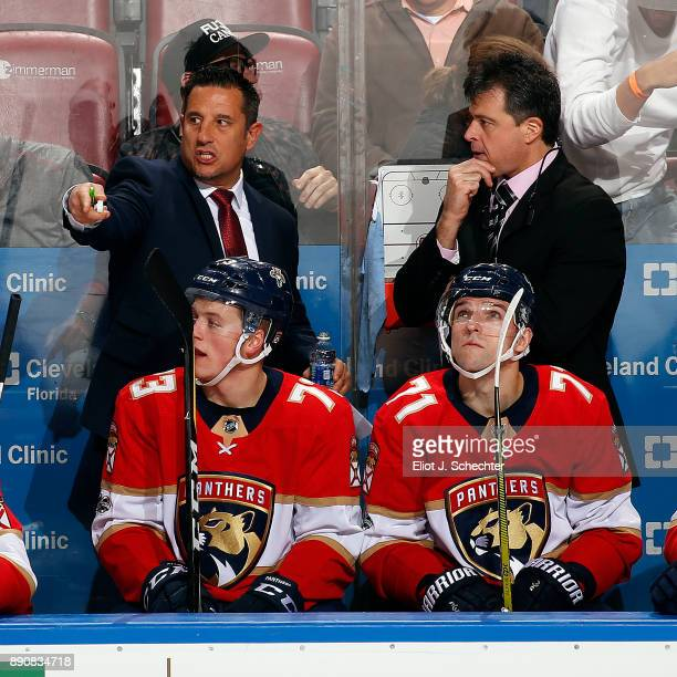 Head Coach of the Florida Panthers Bob Boughner directs his team from the bench along with Associate Coach Jack Capuano during a break in the action...