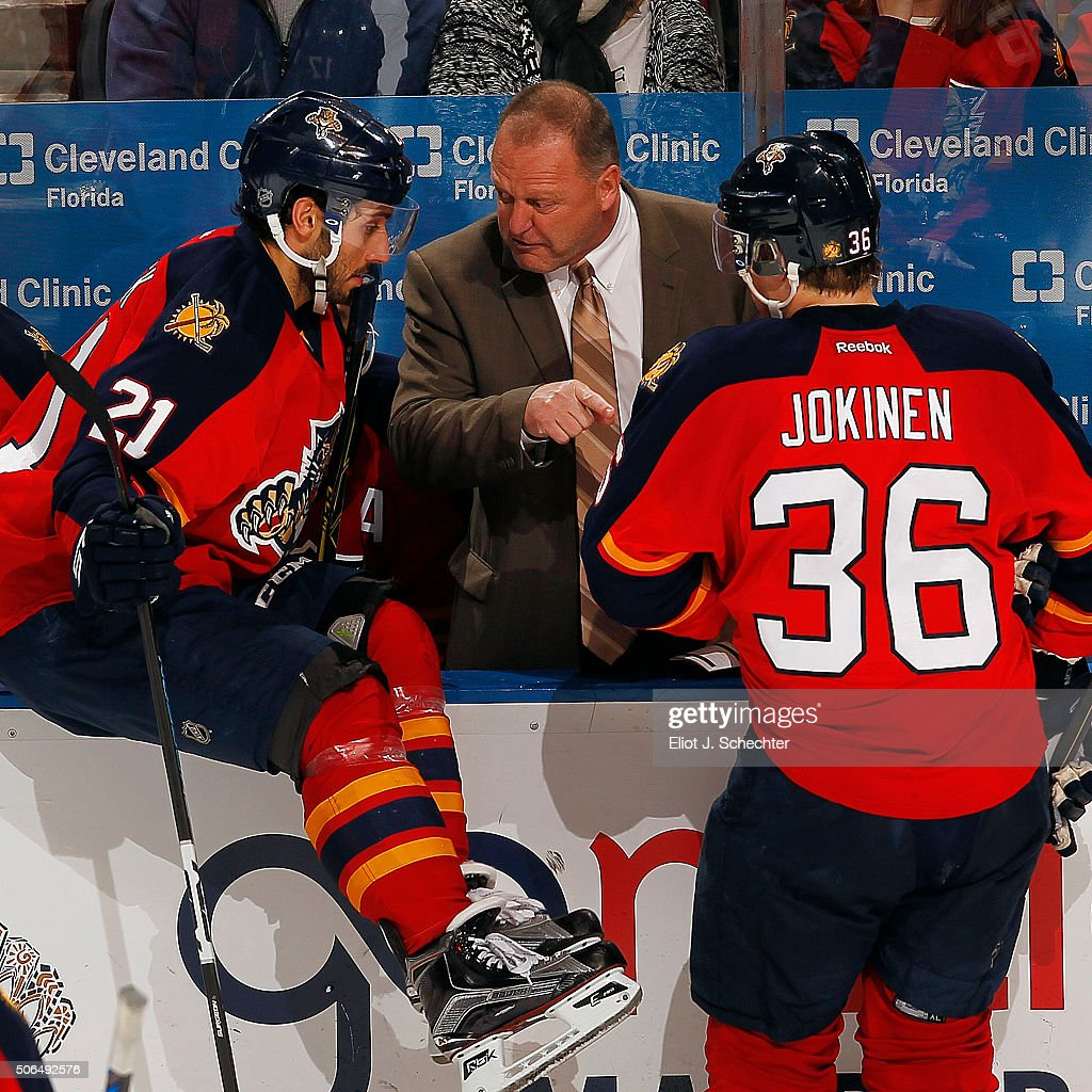 Head Coach of the Florida Panthers <a gi-track='captionPersonalityLinkClicked' href=/galleries/search?phrase=Gerard+Gallant&family=editorial&specificpeople=704668 ng-click='$event.stopPropagation()'>Gerard Gallant</a> chats with <a gi-track='captionPersonalityLinkClicked' href=/galleries/search?phrase=Vincent+Trocheck&family=editorial&specificpeople=6675079 ng-click='$event.stopPropagation()'>Vincent Trocheck</a> #21 and <a gi-track='captionPersonalityLinkClicked' href=/galleries/search?phrase=Jussi+Jokinen&family=editorial&specificpeople=570599 ng-click='$event.stopPropagation()'>Jussi Jokinen</a> #36 during a break in the action against the Tampa Bay Lightning at the BB&T Center on January 23, 2016 in Sunrise, Florida.