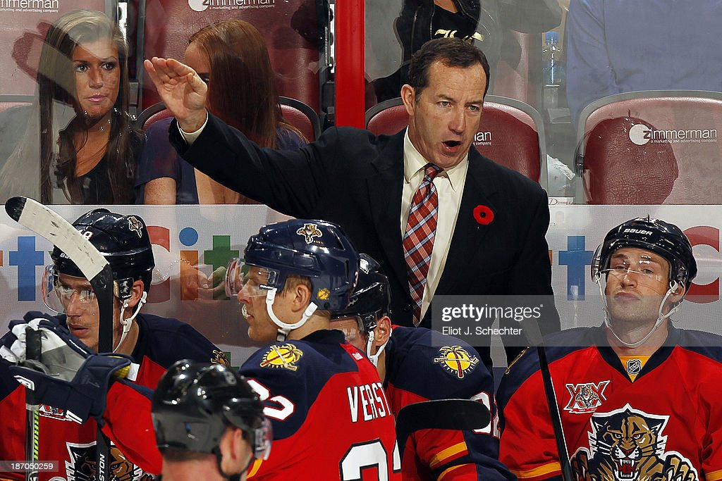 Head Coach of the Florida Panthers <a gi-track='captionPersonalityLinkClicked' href=/galleries/search?phrase=Kevin+Dineen&family=editorial&specificpeople=654130 ng-click='$event.stopPropagation()'>Kevin Dineen</a> directs his team from the bench during a break in the action against the Edmonton Oilers at the BB&T Center on November 5, 2013 in Sunrise, Florida.