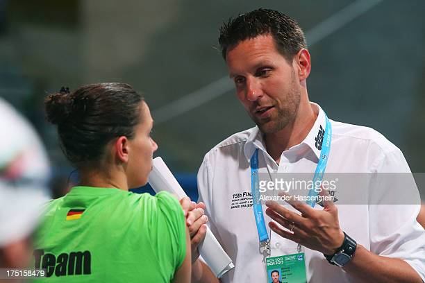 Head coach of the German Swimming Federation Henning Lambertz looks on ahead of the Swimming evening session on day thirteen of the 15th FINA World...
